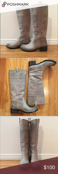 """Lucky Brand Heloisse' Riding Boots Literally only worn around the house.  These are an 7 sz The color on these is hard to describe, sort of gray sort of taupe.  MSRP : $239.95 Details & Care Richly pebbled leather defines a tall, timeless boot styled with a rounded toe, subtle stitching and pull-tabs at the cuff. 1 3/4"""" heel; 1/2"""" platform (size 7) 15 1/4"""" boot shaft; 14 1/2"""" calf circumference. Pull-on style with elastic top goring. Leather upper/synthetic lining/rubber sole. By Lucky Brand…"""