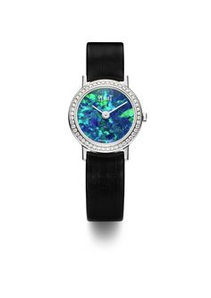 Piaget Altiplano watch in white gold, with an opal face surrounded by brilliant-cut diamonds. Opal Jewelry, High Jewelry, Stone Jewelry, Jewellery, Timex Watches, Women's Watches, Wrist Watches, Amazing Watches, My Birthstone