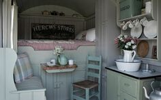 Shepherd's hut in England - you can stay there. LOVE the romantic feel of this interior!