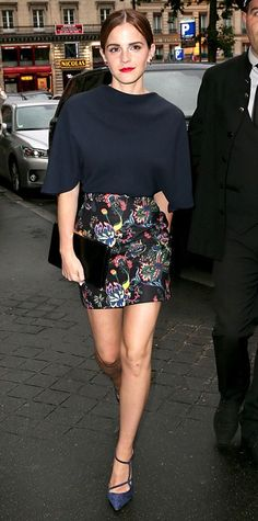 Emma Watson switched out of her couture and into something slightly more casual for the Dior private dinner, pairing her floral print Dior mini with a navy Dior top. Anita Ko earrings, a black clutch and blue strappy Roger Vivier pumps rounded out her look.