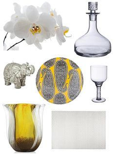 Decanter - Urban Nature Basics Decanter (Villeroy & Boch), Flowers - Orchids, Elephant candle - Zara Home, Wine glass - Urban Nature Basics Casual-Bistro Red Wine Goblet (Villeroy & Boch), Serving plate - Zara Home, Vase - Aurora (Crate and Barrel), Silver placemat - Zara Home.
