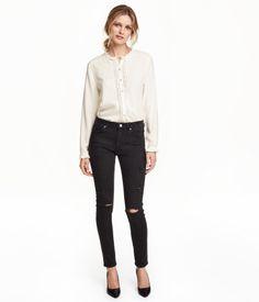5-pocket jeans in washed superstretch denim. Heavily distressed details, regular waist, and slim legs.