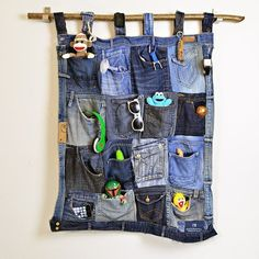 The Best Upcycled Denim Crafts & DIY Why not recycle your old jeans into something fabulous. Denim is a fantastic fabric to upcycle with, here are some of the best denim crafts and DIY's to inspire you. Wall Pocket Organizer, Fabric Organizer, Diy Organizer, Artisanats Denim, Denim Purse, Denim Pants, Blue Denim, Folding Jeans, Denim Scraps