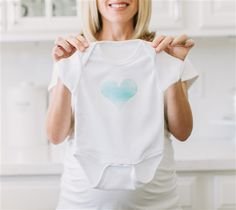 Blue Watercolor Heart Onesie by The TomKat Studio. Make It Now with the Cricut Explore machine in Cricut Design Space.