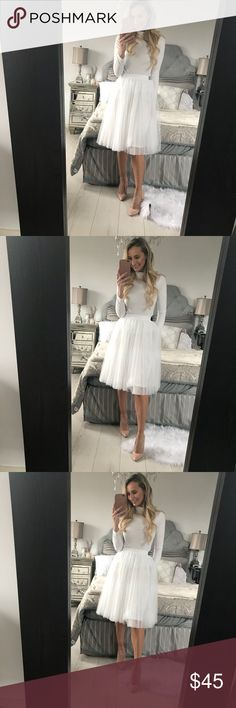 White Tulle Skirt With Elastic Band Three layer Tulle, 1 later liner, total of 4 layers! Material: Mesh Size: One Size Elastic Waist: 23-31.3 Length: 24.8 Little Pearls of Life Skirts Midi