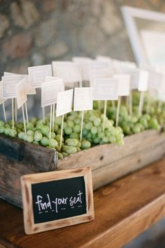 concept: crate of grapes with escort cards for vineyard wedding