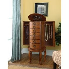 Treat your jewelry to fanciful storage inside the Powell Burnished Oak Round Jewelry Armoire . This jewelry armoire has six drawers for storage along. Wall Mounted Jewelry Armoire, Hanging Jewelry, Jewelry Cabinet, Clean Gold Jewelry, Black Gold Jewelry, Powell Furniture, Home Furniture, Smart Furniture, Accent Furniture
