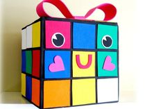 Geeky Valentine's Craft: A Rubix Cube Valentine's mailbox for kids | Instructions at Peppermint Plum