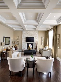 I love everything about this living room... beautiful floors, great wall colour, stone fireplace surround, coffered ceiling, wonderful symmetry, stylish and comfortable furnishings - Jane Lockhart.