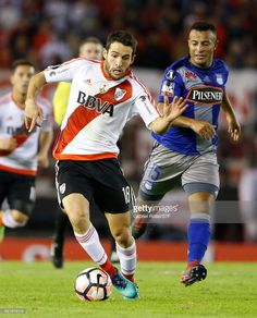 Camilo Mayada of River Plate and Pedro Quinonez of Emelec compete for the ball during a group stage match between River Plate and Emelec as part of Copa CONMEBOL Libertadores Bridgestone 2017 at Monumental Stadium on May 10, 2017 in Buenos Aires, Argentina.
