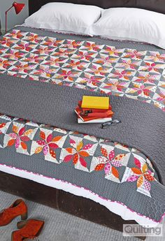 Petals quilt, using freehand machine applique and quilting, by Brioni Greenberg From issue 2 of Love Patchwork & Quilting magazine - buy a copy or subscribe for fab savings here http://www.myfavouritemagazines.co.uk/stitch-craft/love-patchwork-and-quilting-magazine-subscription/  https://www.facebook.com/lovepatchworkandquilting