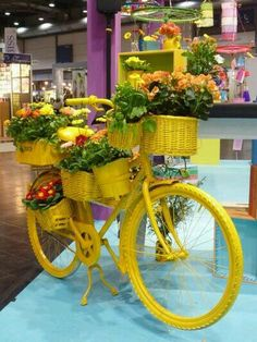 Yellow bike transformed into a garden! antique bike recycled in flower pot Love the multiple baskets! Painted bicycle You can do this with my old bike once you get a new one I seen some like this in Gdansk, PL.