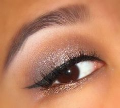 Brown and pink shadows on top, highlight under brow, gold shadow on bottom.