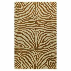 Hand-tufted wool rug with a zebra-print motif.  Product: RugConstruction Material: WoolColor: Copper  Features: Hand-tufted Note: Please be aware that actual colors may vary from those shown on your screen. Accent rugs may also not show the entire pattern that the corresponding area rugs have.Cleaning and Care: Regular vacuuming and spot cleaning recommended