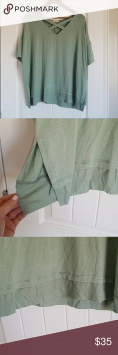 Green Cross Top T-shirt Green. Cute detail on chest. Split sides add character along with designed bottom. Tops