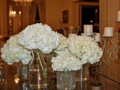 reception flowers - centerpiece ideas - mostly white with perhaps a few purple hydrangeas