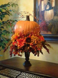 This beautiful autumn pumpkin sitting on a urn creates a beautiful centerpiece. Carefully handcrafted and designed to bring elegance into any home. With warm autumn leaves, sunflowers and roses. made to order Fall Flower Arrangements, Pumpkin Arrangements, Autumn Decorating, Thanksgiving Decorations, Fall Church Decorations, Thanksgiving Wreaths, House Decorations, Thanksgiving Table, Deco Table