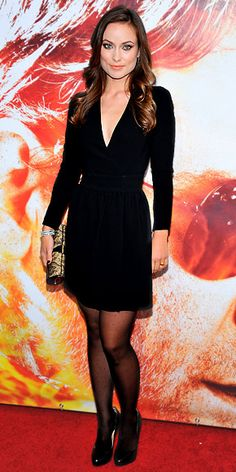 Olivia Wilde wore a plunging long-sleeve minidress with black leather heels to the premiere of The Next Three Days.