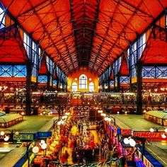 Explore a local market for the day... Central Market Hall, Budapest, Hungary - When visiting Budapest, a must stop is the Central Market. We travelled to this city twice, but it wasn't until our second time that we discovered it. Located on the Pest side of Liberty Bridge, this is a giant shopping centre filled with food, clothing and Hungarian arts and crafts. Lose yourself in there for a day.