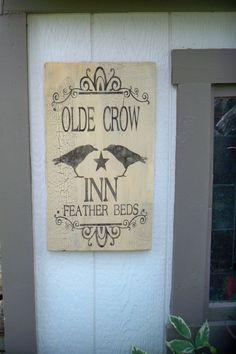 Old Crow Inn weathered handmade sign crackle finish bed and breakfast black crow black white primitive shabby chic ready to ship. $13.50, via Etsy.
