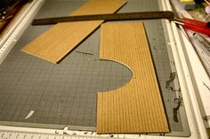 The cardboard subroofs are marked, first with a 7mm line lowest, then with the shingle reveal distance. Use 3 or 4 mm.