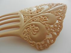 Victorian French Ivory Fleur de Lis Hair Comb from the Early 20th Century via Etsy