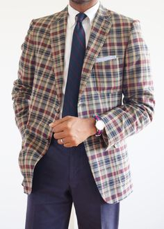 Madras jacket, white OCBD, navy tie with red stripes, navy pants