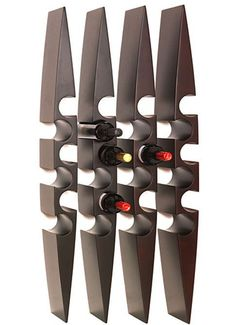 This wine rack is made from metal cut out into an irregular shape. The holes in the oval sort of shape make it an interesting place to keep the wine. Overall this piece is very polished and unusual Cool Wine Racks, Unique Wine Racks, Modern Wine Rack, Wine Glass Rack, Wine Rack Wall, Wine Rack Design, Home Wine Cellars, Home Bar Decor, Bottle Wall