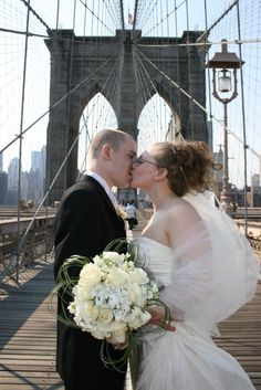 bride and groom on Brooklyn Bridge, after their wedding in Central Park