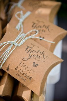 23 Wedding Box Favor Ideas: Brown paper pillow boxes + customized stamps and striped twine {Dezember Photography}