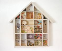 Ways to Display- convert an vintage printers tray into an eye-catching wall decor item. Line the back of each little panel with fabric or wallpaper.  Then give it a lick of paint, colour of your choice and there you have it. Boom revived and refreshed.