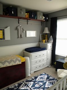 navy, yellow, grey  Changing table area