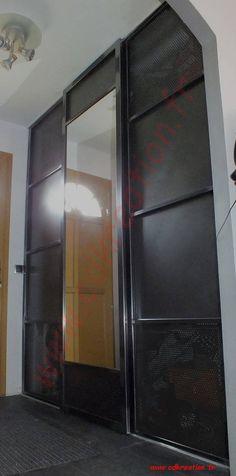 porte de placard coulissante sur mesure au style industriel en acier brut pour une deco loft