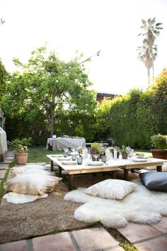 Outdoor dinner party setup with wooden tables, pillow seats, string lights and a buffet table. decor party outdoor dining How to Throw the Perfect Fall Dinner Party in Your Backyard Outdoor Dinner Parties, Garden Parties, Outdoor Entertaining, Backyard Parties, Cozy Backyard, Party Outdoor, Backyard Ideas, Outdoor Dining, Outdoor Spaces