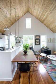 Love the lights hanging down from the high ceiling! #design