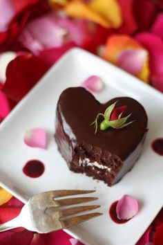 Mini chocolate heart cakes with raspberry cream and chocolate ganache.