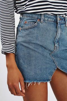 Swap out your shorts for something with a little more edge in the MOTO denim mini skirt skirt. Featuring cut out detail on the front, it sits high on the waist for a flattering fitted silhouette. #Topshop