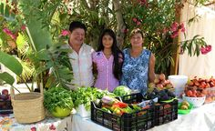 Eugenio Llerena and his family selling their local products