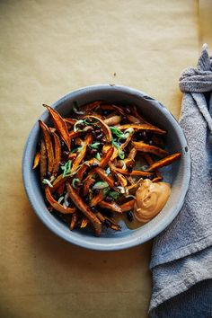 Curry garlic sweet potato fries are sure to cure what ails you (plus: miso gravy!).