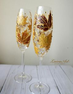Fall Wedding Champagne Flutes Wedding Flutes Fall Wedding Toasting Flutes These are hand painted set of 2 white champagne glasses painted by me. These would make a wonderful gift for your favorite person. You can have these glasses personalized with names or dates for free. I can do custom orders too if you like of another design or style of glass, just let me know. I will try my best to get what you need. If you are looking for matching accessories please visit our sections: Matching Ca...