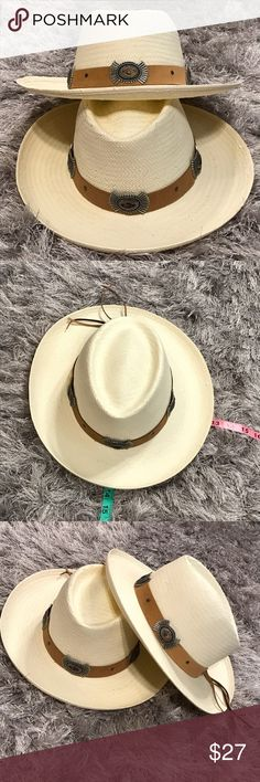 """NWOT Scala Raffia Panama Gambler Hat SZ Med/22.5"""" This is for ONE hat. New w/o tags. Scala Collection. Cream raffia.  Non-removable brown leather band w/ antiqued silver accents. Inside circumference is 22 1/2 inches. Brim is 3 inches. Crown height is 4 1/2 inches. Crown width is approximately 4 1/2 inches. Brim to brim measurements are 14"""" x 13"""". Unisex. Very small, less than pencil eraser size,  discoloration that pretty much only shows on the inside. Made in the USA. Scala Accessories…"""