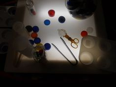 Bottle caps at the light table...
