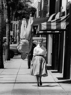 Acrobat and actor, Russ Tamblyn doing a flip on the sidewalk with starlet Venetia Stevenson Location: Hollywood, CA, US Date taken: August 1955 Photographer: Allan Grant Gordon Parks, Sports Pictures, Cool Pictures, Hollywood, Russ Tamblyn, Happy Leap Day, Vogue Covers, Black N White Images, Black White