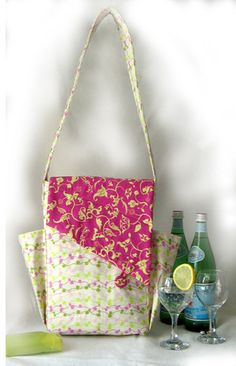 Carry snacks or glasses in the side pockets of the Bevy Bag.