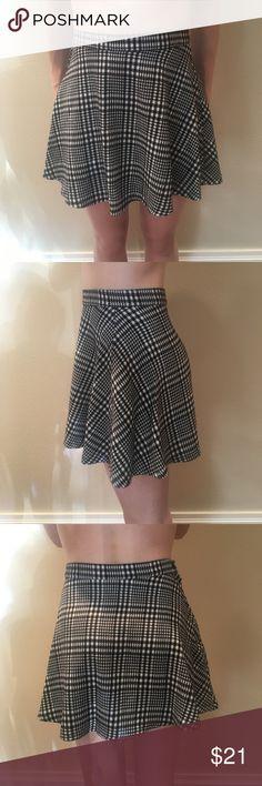 "AA Plaid Mini Skirt Black & white mini skirt. The model is 5'6"". Feel free to make a reasonable offer. American Apparel Skirts Mini"
