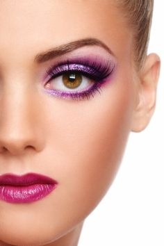 Semi-portrait of a beautiful caucasion face with bright violet coloured make up and plum lips