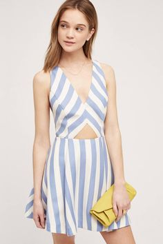 1c5e31f70d077c Blue and white striped Tula Rose dress with cut out at the mid section .