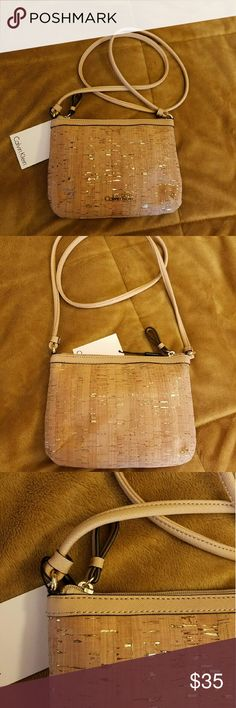 """SOLD Bundled NWT Calvin Klein Crossbody cork bag. NWT. Crossbody bag with cork like finish that has a gold specs. Zipper closure. Zipper pocket and open pocket inside. Measurements: Across: 8.5"""" Tall: 6"""" Strap is 22"""" (from shoulder to bag.) Calvin Klein Bags Crossbody Bags"""