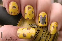 Cute!  I like the depth she got with the cheese holes! Mouse and Cheese Nail Art manicure
