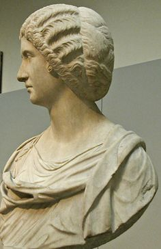 Portrait bust in marble of a woman associated with the imperial family, displaying the complex hairstyle of the Antonine women. Roman. c. 180-200 CE. London: British Museum.